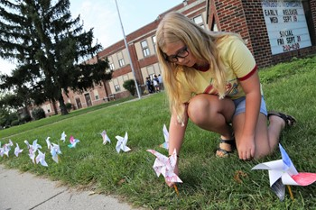 SI Student with Pinwheel for Peace