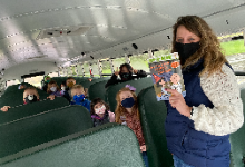 Bus Driver Reads to Students